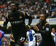 Adebayor esulta dopo aver segnato con il City