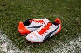 Scarpe evoPower 1.2 bianche arancioni nere