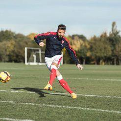 Olivier Giroud test Puma evoPower Vigor 1 arancioni